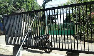 Jasa Pembuatan Pintu Garasi Dan Kanopi Minimalis Jatibening Bekasi