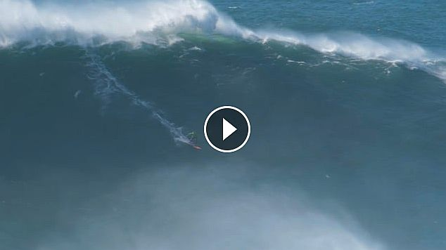 Carlos Burle riding a monster wave in Nazaré