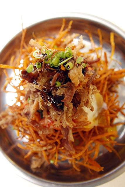 I AM KIM Sweet Potato Shoestring Fries with Adobo Flakes, Kimchi, and poached egg