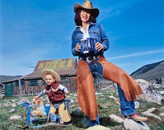 Image: The author and her son Harper, channeling their inner cowpoke outside a lodge she owns in Stanley, Idaho.