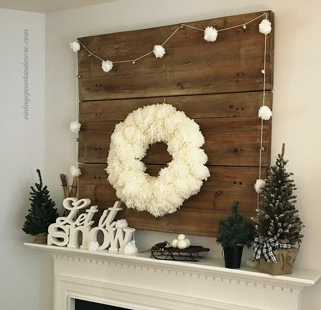 Vintage Paint and more... a winter mantel transitioned from a Christmas mantel using a diy yarn pom-pom wreath and garland and rustic winter decor pieces