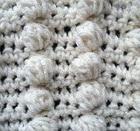 http://translate.googleusercontent.com/translate_c?depth=1&hl=es&rurl=translate.google.es&sl=en&tl=es&u=http://www.allfreecrochet.com/Tutorials/How-to-Crochet-a-Popcorn-Stitch&usg=ALkJrhiUyfRwKR6u3K1YXae926OL0r1qhg