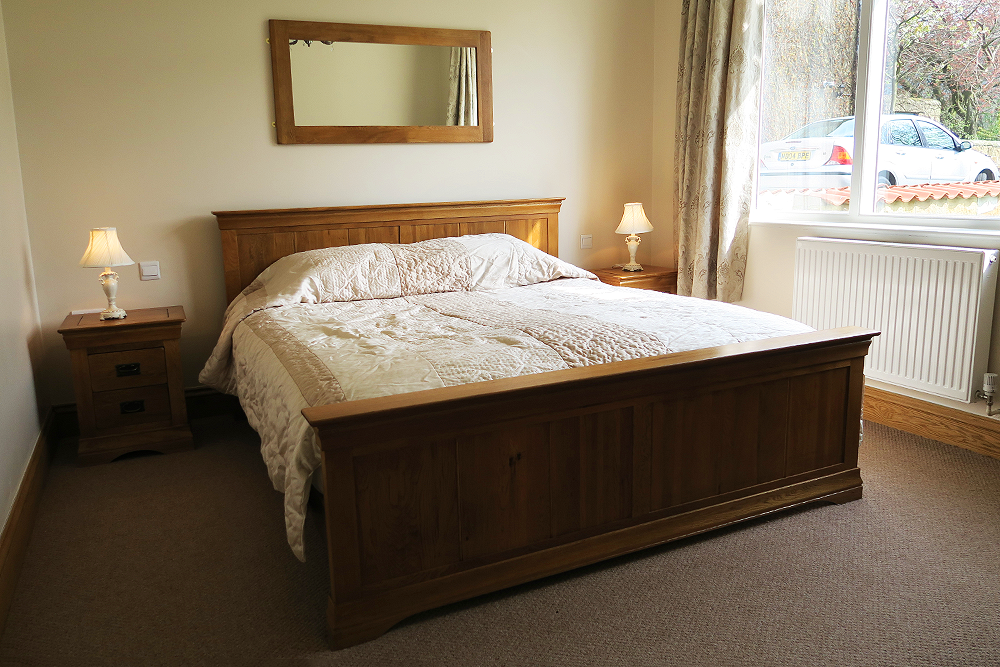 Bedroom in the Hornsea luxury suite at Ox Pasture Hall, Scarborough