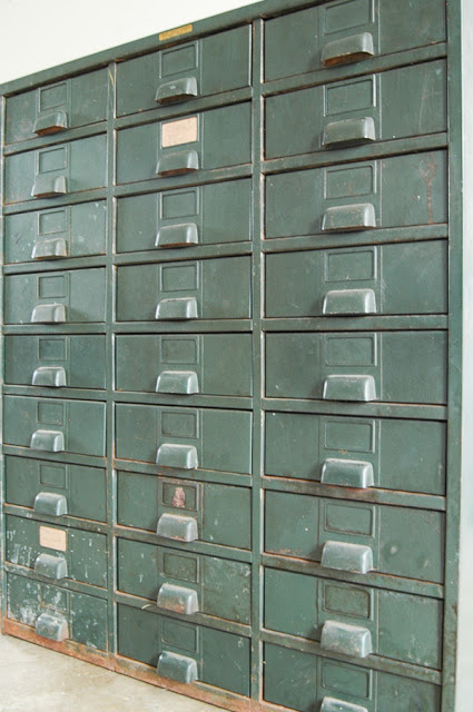 Vintage metal hardware cabinet full of rust