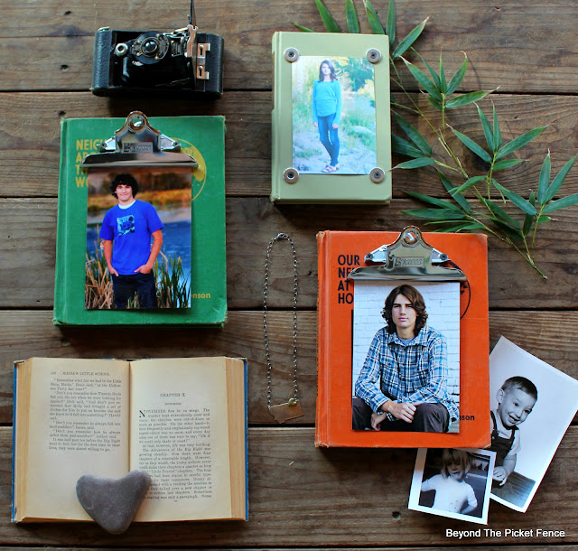 use old vintage books from the thrift store as photo holders or picture frames