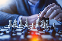 an image showing a person playing chess