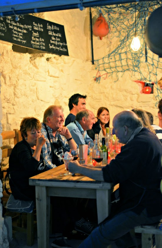People dining at Hell Bay Hotel Crab Shack on Bryher Isles of Scilly