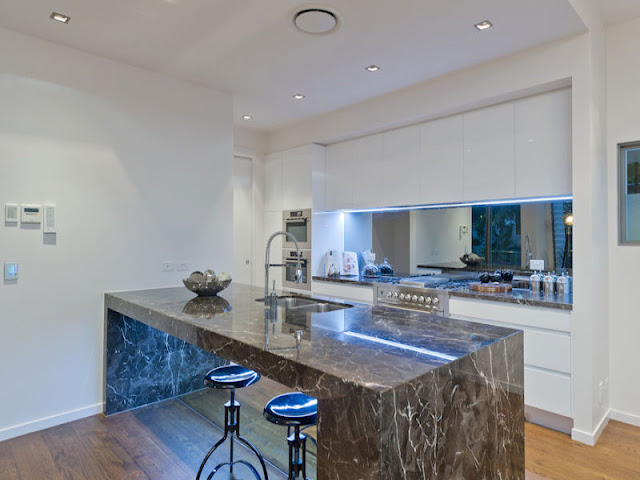 Photo of modern dark marble kitchen island in the kitchen of contemporary modern home in Brisbane