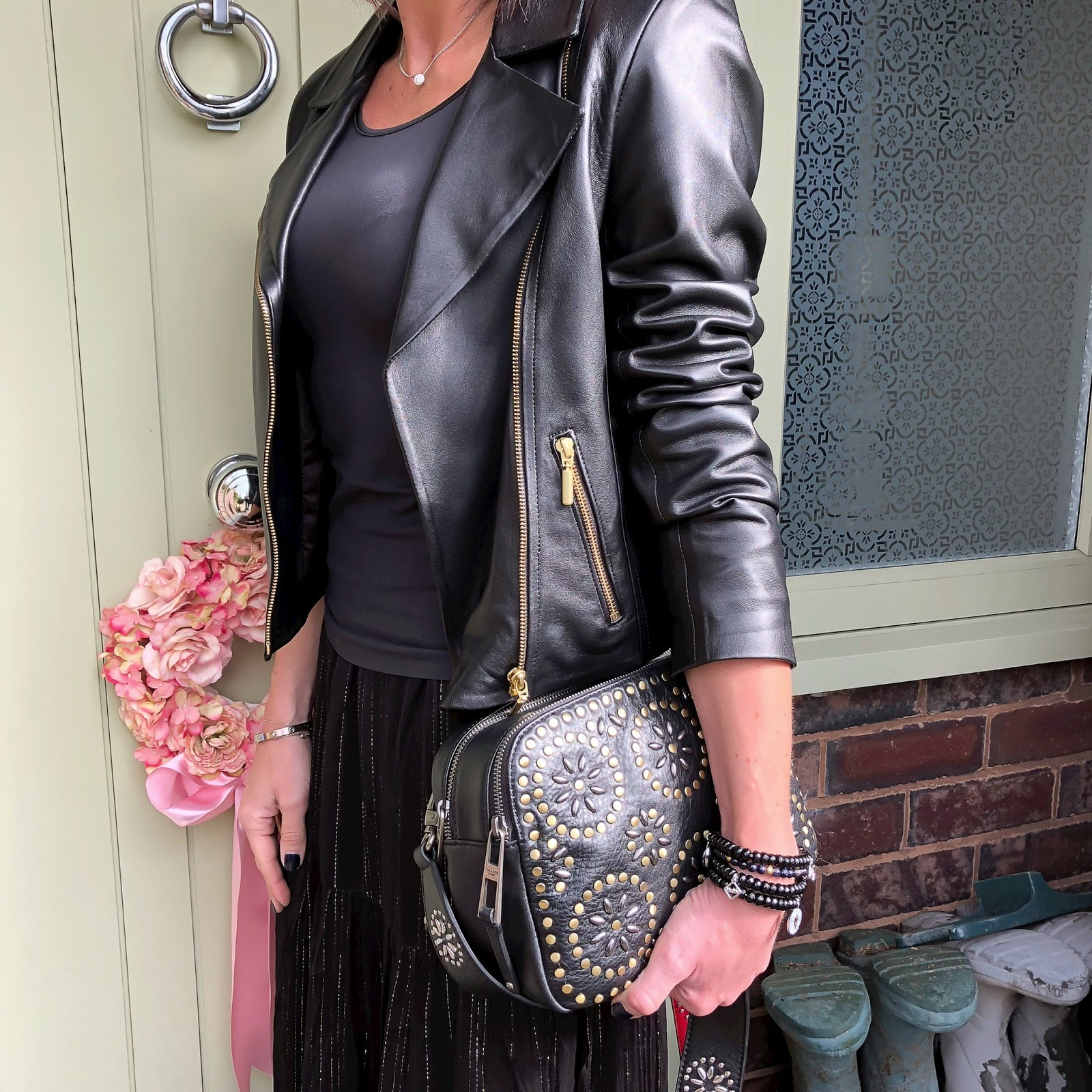 my midlife fashion, become tank top, village england pemberton studded cross body bag, baukjen everyday leather biker jacket, and other stories metallic maxi skirt, j crew pointed mesh flats