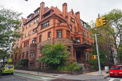 Sandstone, salmon colored brick and terra-cotta mansion on corner lot