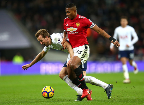 Valencia tackles Harry Kane during Manchester United vs Tottehanm