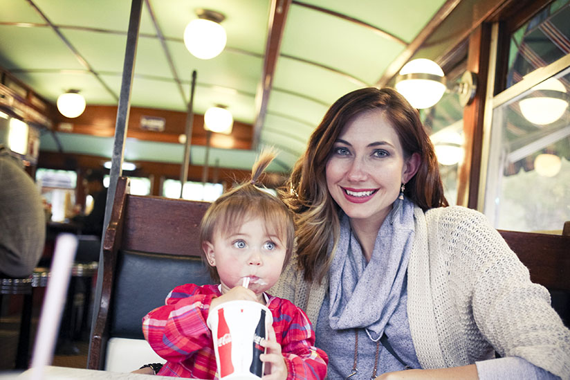 Amy West and her daughter London enjoy dinner in the Streamliner location of Sandfly BBQ in Savannah Georgia