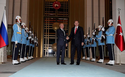 President of Turkey Recep Tayyip Erdogan greeting Russian President Vladimir Putin.