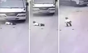 Smart toddler almost run over by truck in China