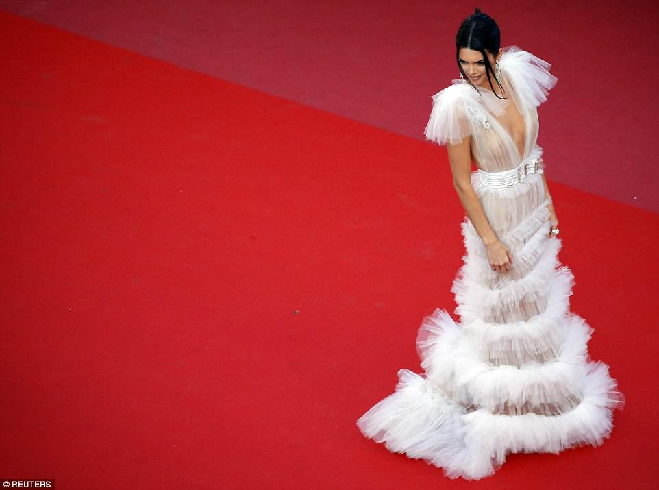 Kendall Jenner bares all as she goes braless in transparent frilled gown at the star-studded Girls of the Sun premiere