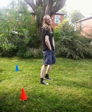 Boy in goal with cones in garden