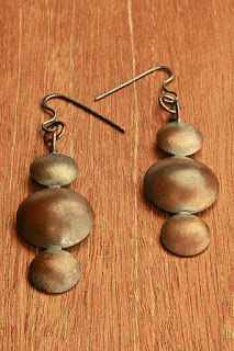 copper pair of earrings with silver hooks