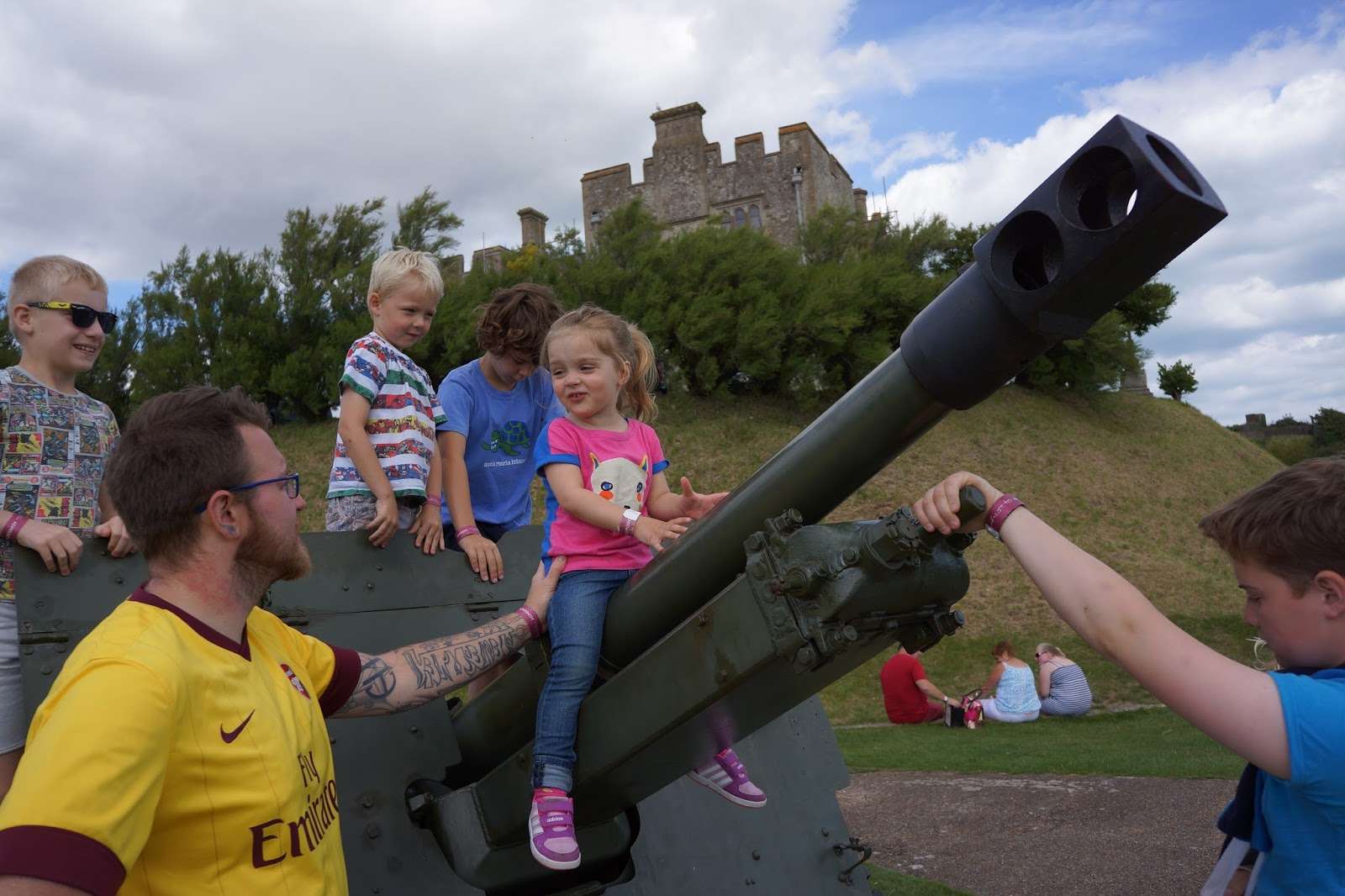 children climbing a tank at dover castle