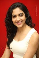Actress Ritu Varma Stills in White Floral Short Dress at Kesava Movie Success Meet .COM 0213.JPG
