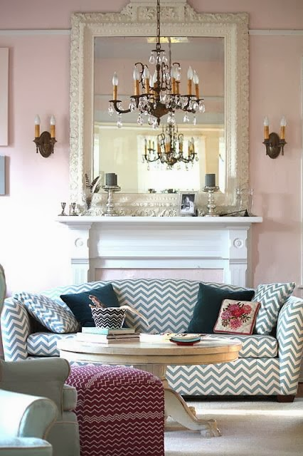 dusty pink walls with chevron sofa