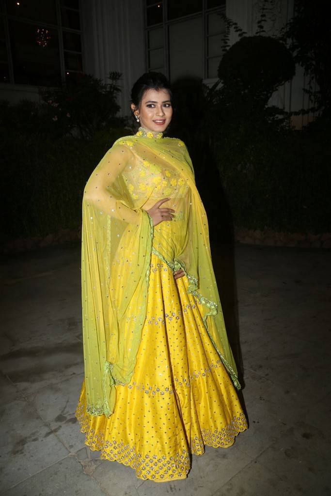Hebah Patel Stills At Audio Success Meet In Yellow Dress