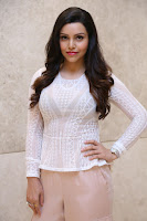 Kyra Dutt in Tight White Top Trousers at Paisa Vasool audio success meet ~  Exclusive Celebrities Galleries 019.JPG