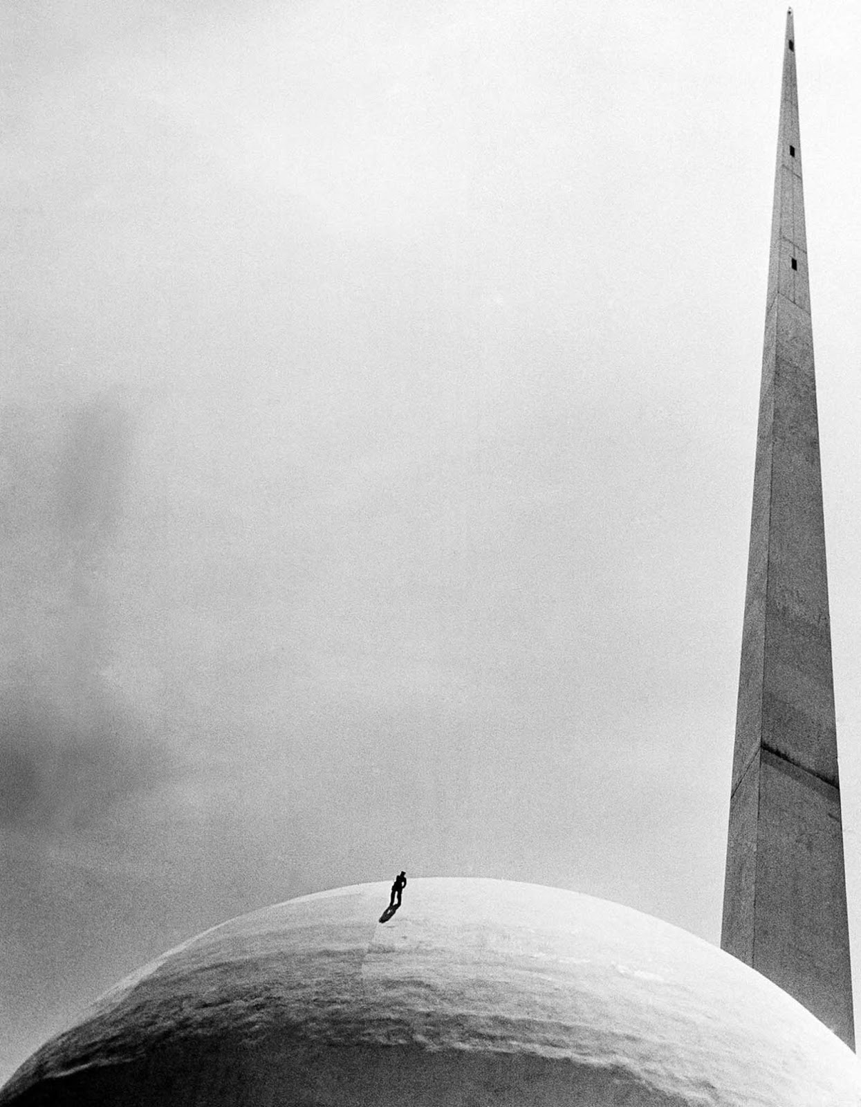 A workman at New York World's Fair repaints the famed Perisphere, on June 6, 1939.