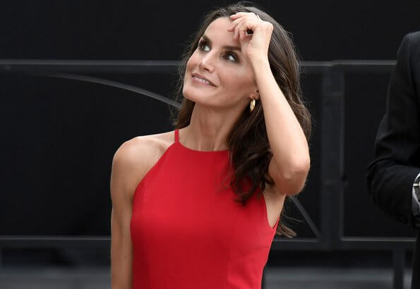 Queen Letizia wore a halter neckline red dress by Carolina Herrera, and nude patent leather slingback pumps, and animal print clutch
