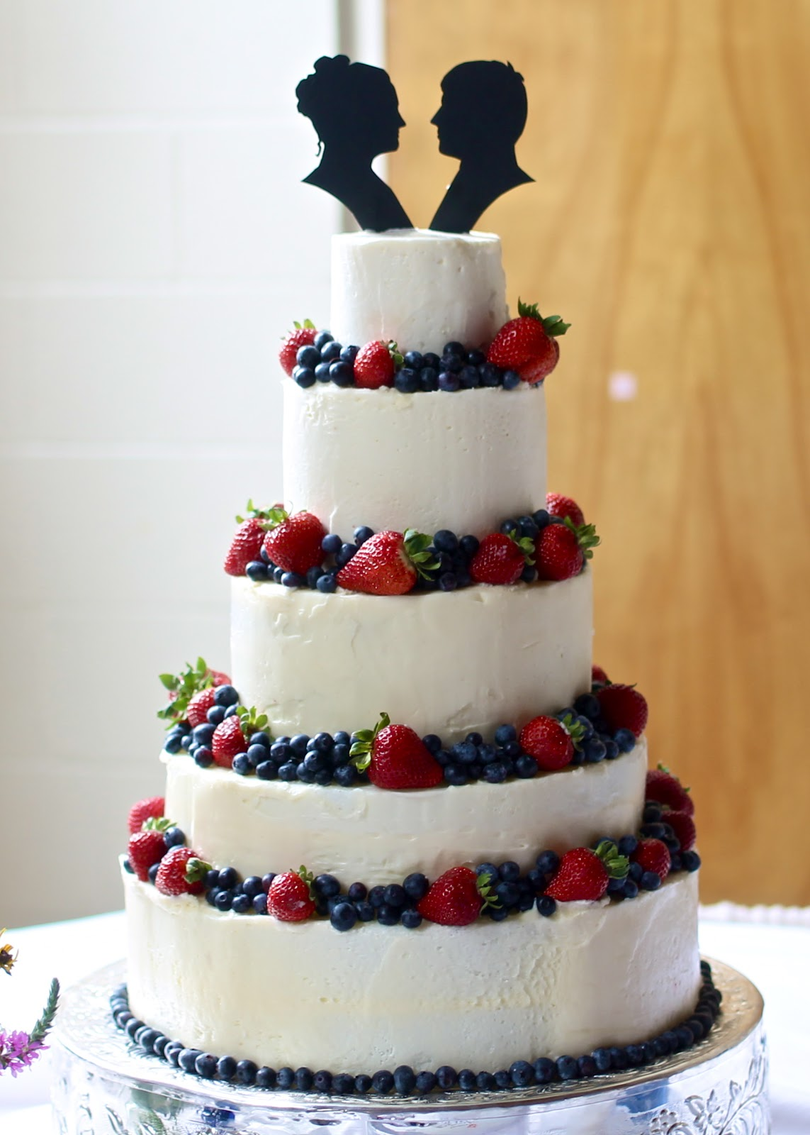 Yammie s Noshery  Wedding Cake with Berries and Silhouette Toppers