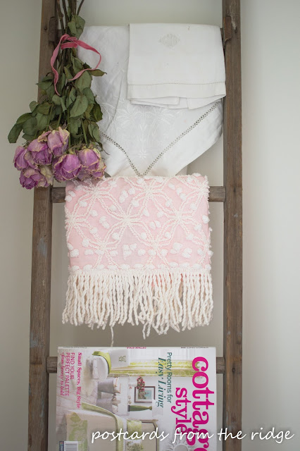 Old ladder with vintage linens and dried flowers. Lots of great decorating ideas on this site. Postcards from the Ridge