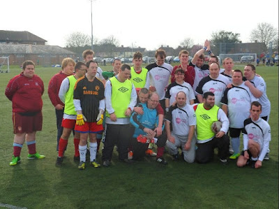 Photo of Thurrock Mencap's Full Football Team, all crouched together.