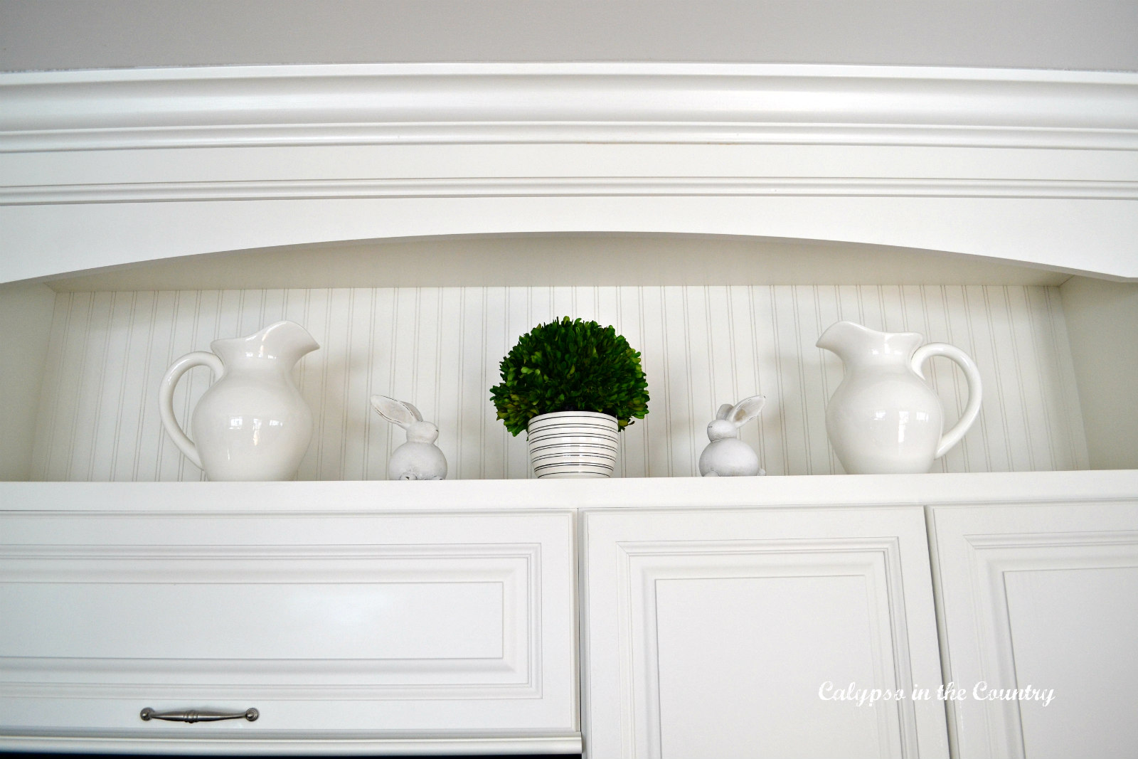 White pitchers, bunnies and beadboard