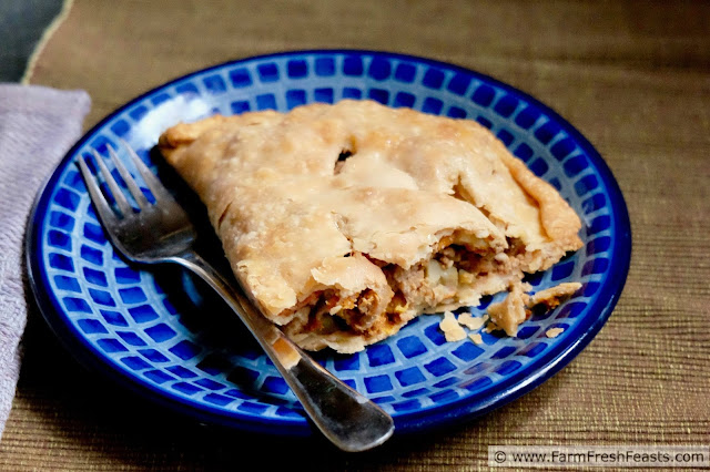 photo of a sausage and vegetable-stuffed meat pie