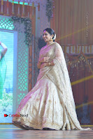 Actress Rakul Preet Singh Stills in Golden Embroidery saree at Rarandoi Veduka Chuddam Audio Launch .COM 0021.jpg