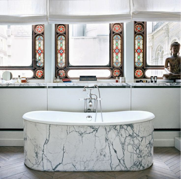 bathroom with tiffany glass windows, tub with heavinly veined marble