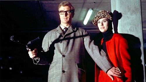 Michael Caine with machine gun and co-star in The Ipcress File