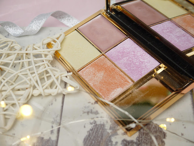 A copper palette with peach, lemon, lilac, and nude highlighters