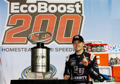 William Byron, driver of the #9 Liberty University Toyota, poses with the trophy in Victory Lane after winning the NASCAR Camping World Truck Series Ford EcoBoost 200. #nascar