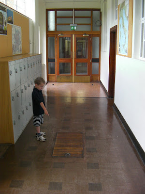 the trapdoor to the tunnels, merchant taylors school
