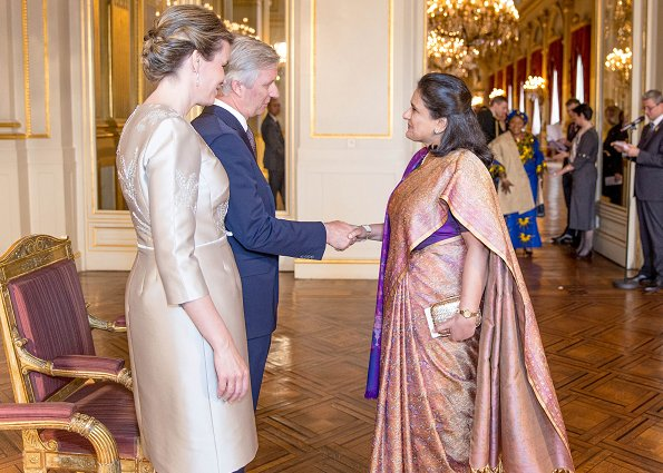 King Philippe and Queen Mathilde hosted traditional New Year reception at the Royal Palace. Queen wore Natan dress and pumps