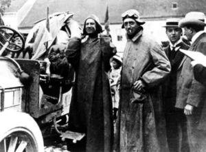 Scipione Borghese (left) and journalist Luigi Barzini pictured with Borghese's Itala car