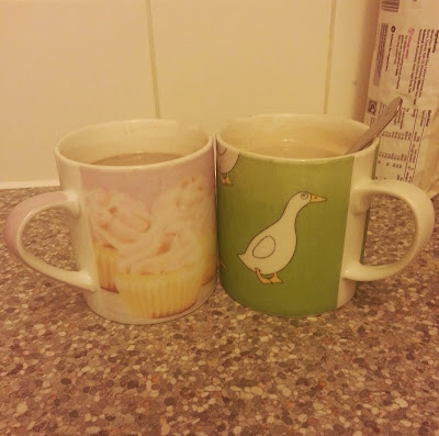 Two mugs full of hot chocolate