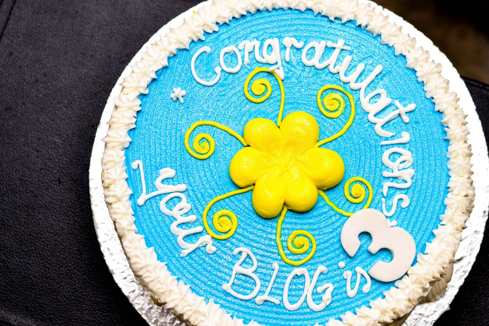 Yellow Flower on a Blue Glitter Cake