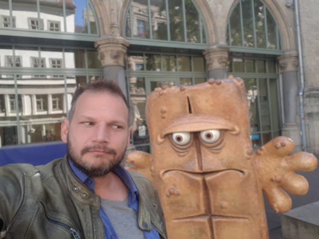 The Social Traveler & Bernd das Brot aka Bernd the bread hanging out in Erfurt