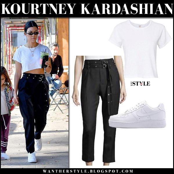 Kourtney Kardashian in white crop top, black iro pants and white sneakers nike air force street style december 31
