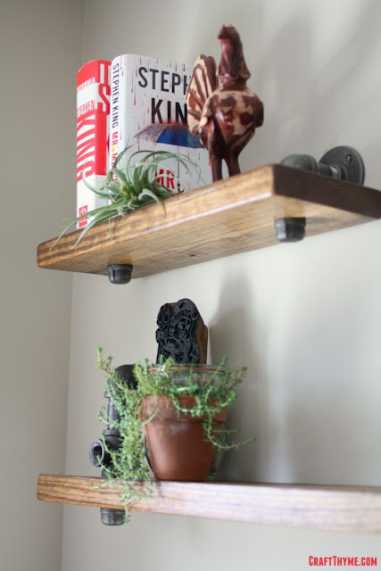 industrial pipe and wood bookshelves