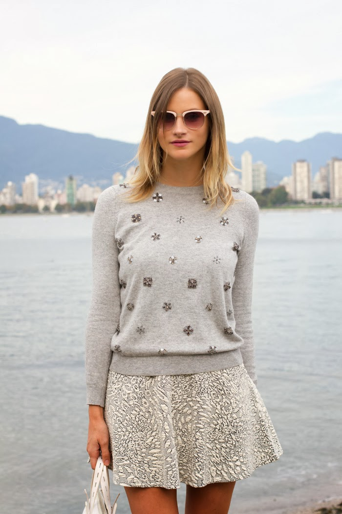 Vancouver Fashion Blogger, Alison Hutchinson, wearing a Topshop Grey embellished sweater, Topshop Grey skater skirt, Vince Camuto brown ankle booties, a white tote from Zara and pink framed sunglasses from Urban Outfitters