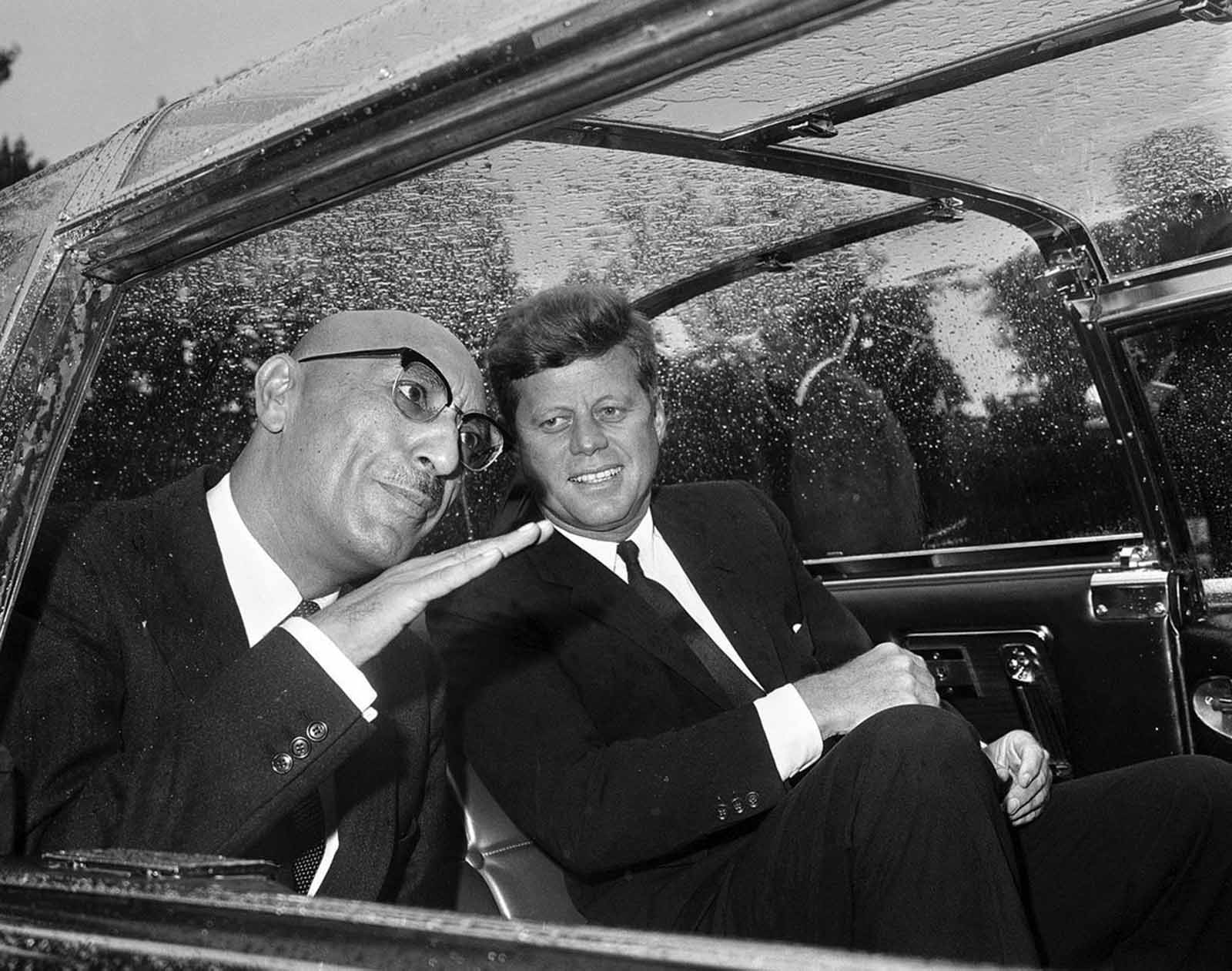In Washington, District of Columbia, Afghan King Mohammad Zahir Shah talks with US President John F. Kennedy in the car that took them to the White House on September 8, 1963.