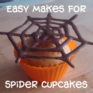Cupcake in orange color case with chocolate spiderweb topper
