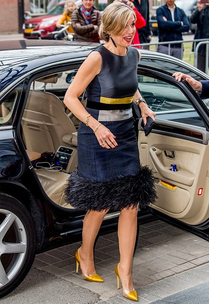 Queen Maxima attends the opening of the StudyPortals in Eindhoven. Queen wore Oscar de la Renta Sleeveless Lame Dress with Feather Hem